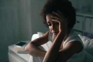 Depressed woman in bed, can't sleep