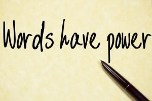 Words have power - written in black across yellow background