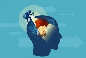 Person shinning a light into a human head revealing mechanisms inside