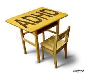 ADHD Written large on yellow school desk