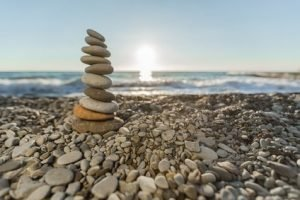 A stack of smooth stoned balanced on a rocky beach